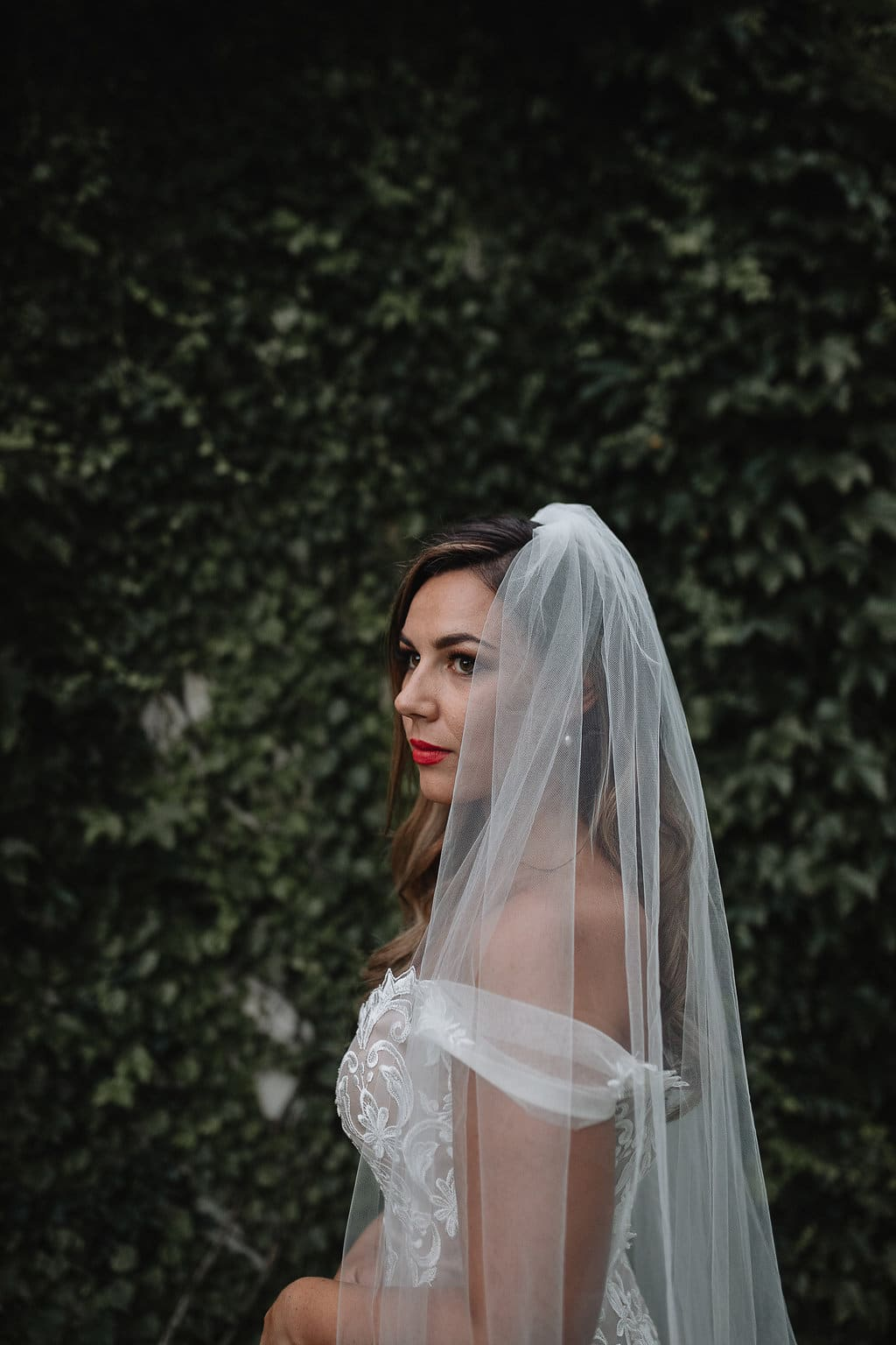 Real Weddings | Vinka Design | Real Brides Wearing Vinka Gowns | Amber and Rhys - Amber close up top half with veil and off shoulder custom made dress