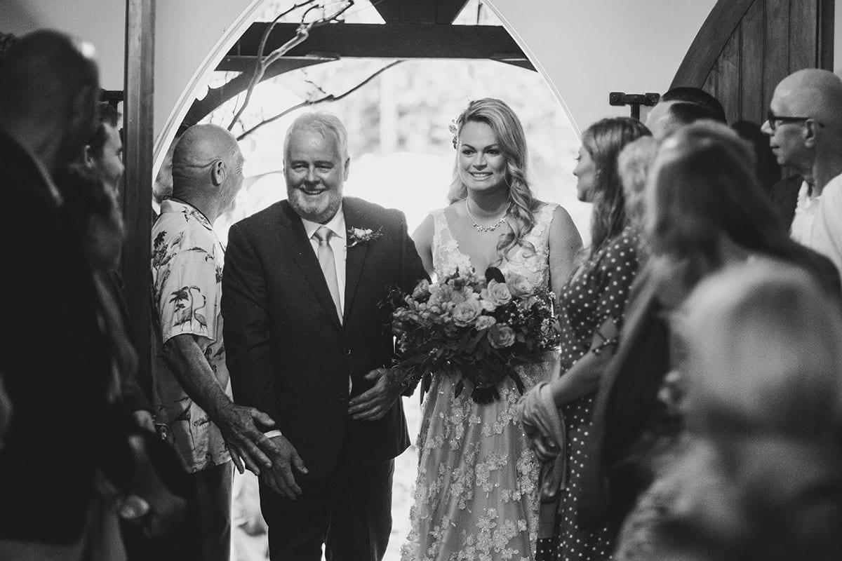 Real Weddings | Vinka Design | Real Brides Wearing Vinka Gowns | Megan and Tim - Megan being walked into chapel