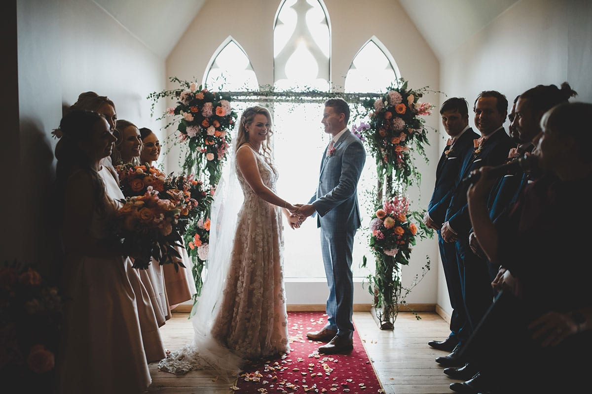 Real Weddings | Vinka Design | Real Brides Wearing Vinka Gowns | Megan and Tim in small chapel ceremony