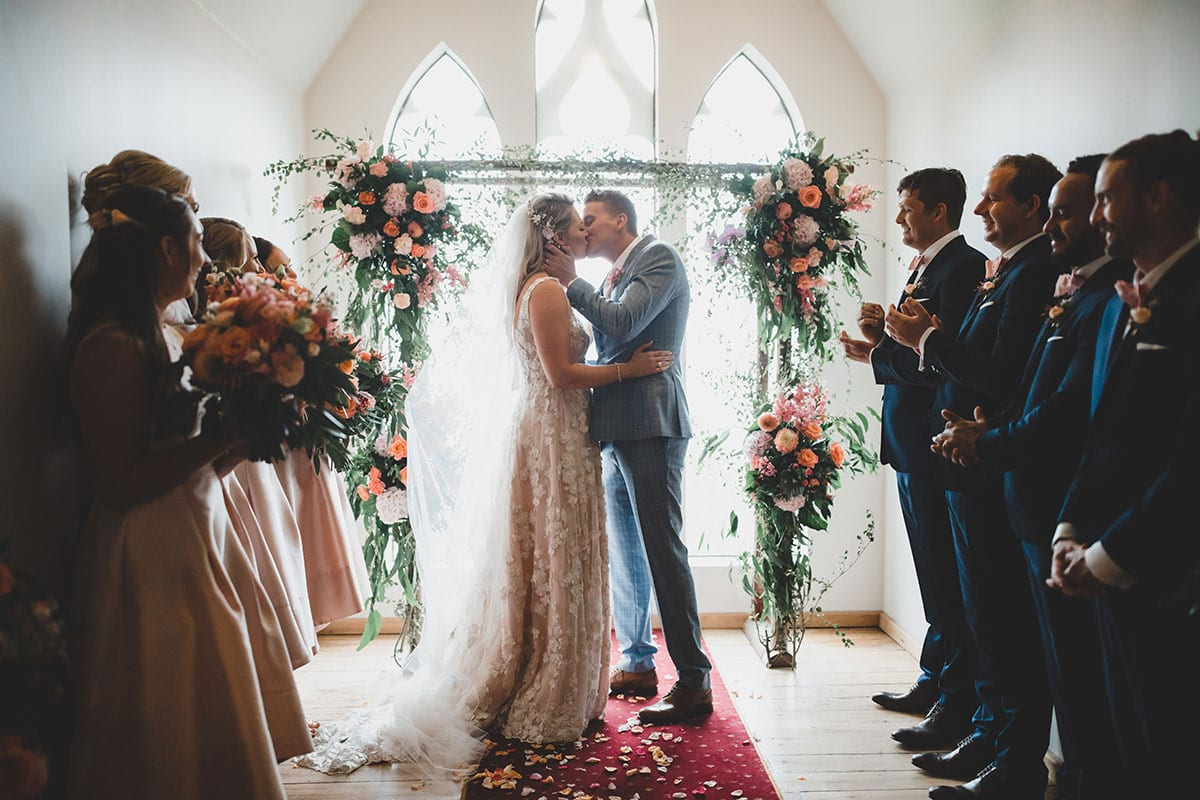 Real Weddings | Vinka Design | Real Brides Wearing Vinka Gowns | Megan and Tim kiss in ceremony