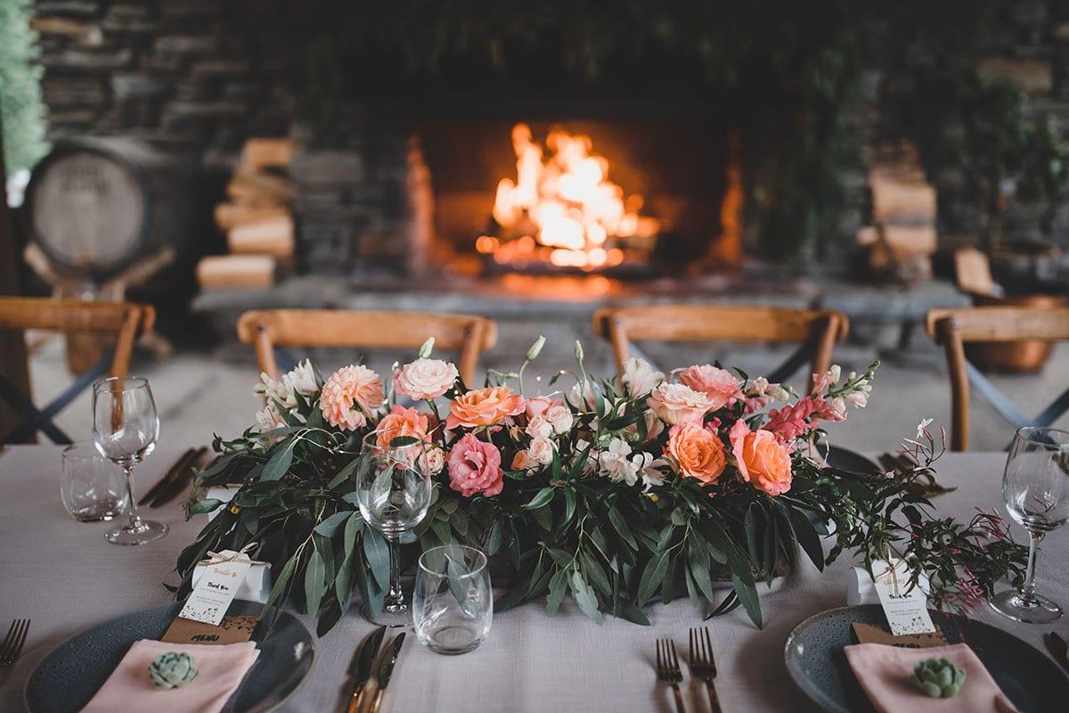 Real Weddings | Vinka Design | Real Brides Wearing Vinka Gowns | Megan and Tim wedding reception table setting flowers
