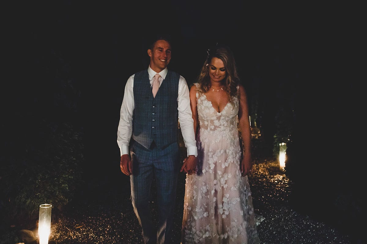Real Weddings | Vinka Design | Real Brides Wearing Vinka Gowns | Megan and Tim at night time reception Megan in a custom made Vinka designer gown
