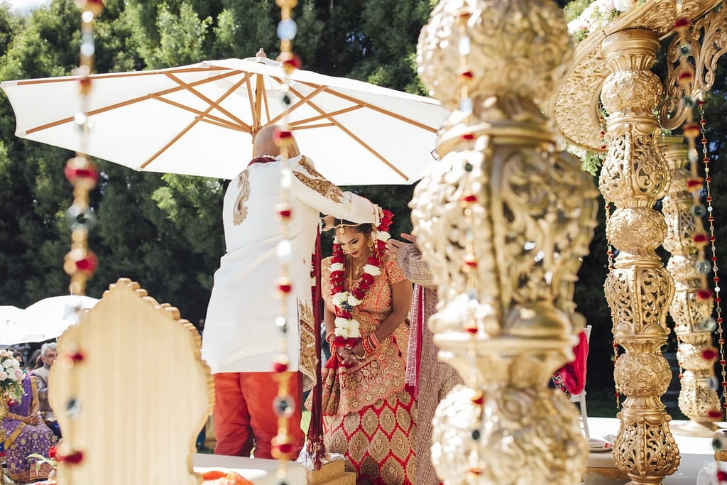 Real Weddings | Vinka Design | Real Brides Wearing Vinka Gowns | Shalini and Jayesh -Shalini through decoration taking part in INdian ceremony