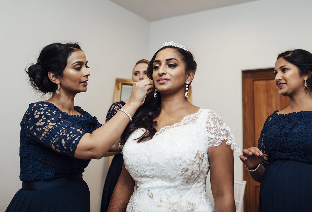 Real Weddings | Vinka Design | Real Brides Wearing Vinka Gowns | Shalini and Jayesh - Shalini getting ready with bridesmaids help