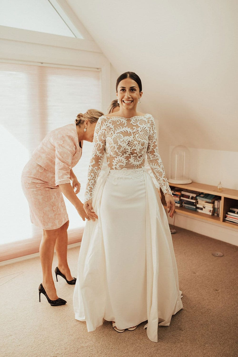 Real Weddings | Vinka Design | Real Brides Wearing Vinka Gowns | Olivia and Ben - Olivia getting ready, beautiful detail of bodice with nude base and lace detail