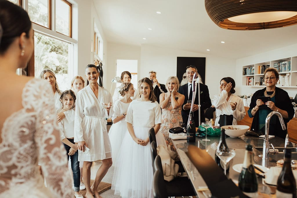 Real Weddings | Vinka Design | Real Brides Wearing Vinka Gowns | Olivia and Ben - Olivia bridal party getting ready first sight of beautiful bespoke dress