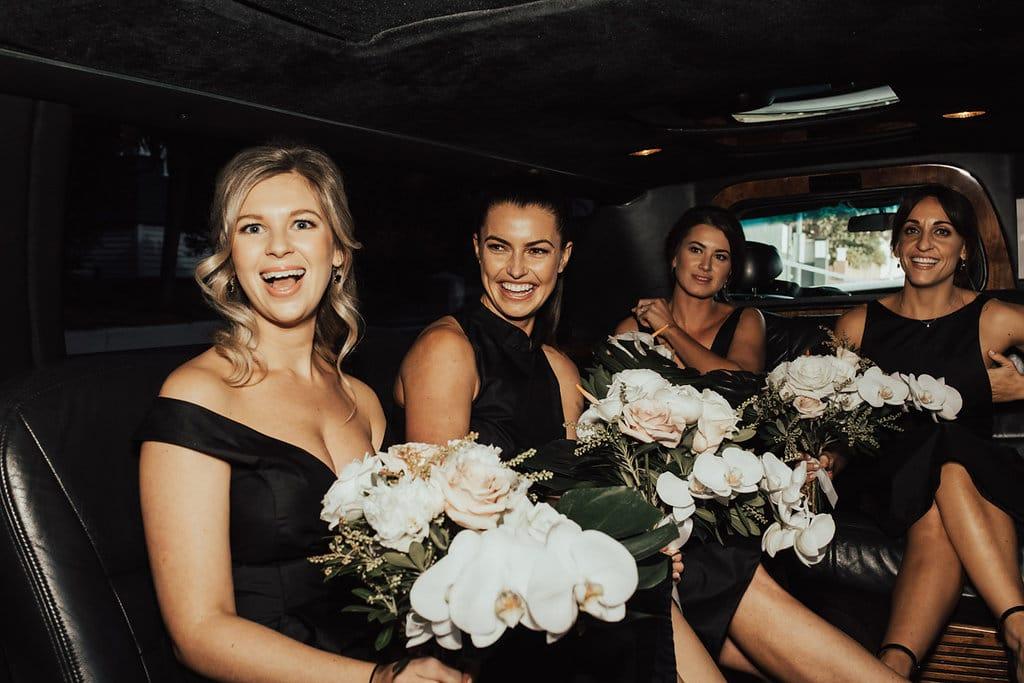 Real Weddings | Vinka Design | Real Brides Wearing Vinka Gowns | Olivia and Ben - bridesmaids in wedding car