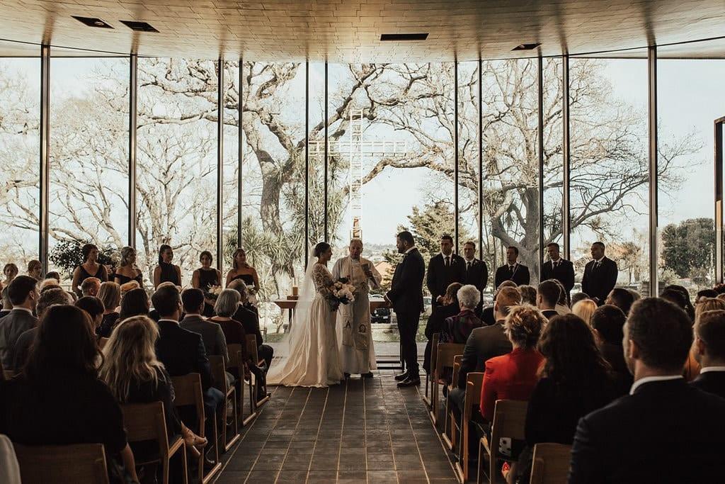 Real Weddings | Vinka Design | Real Brides Wearing Vinka Gowns | Olivia and Ben wedding ceremony at Bishop Selwyn Chapel