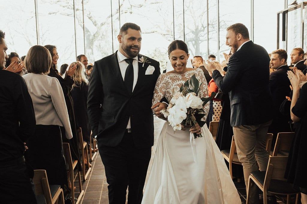 Real Weddings | Vinka Design | Real Brides Wearing Vinka Gowns | Olivia and Ben walking down aisle
