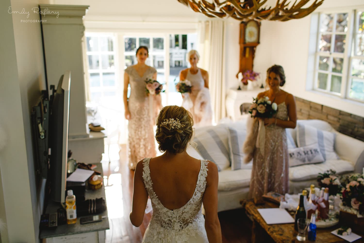 Real Weddings | Vinka Design | Real Brides Wearing Vinka Gowns | Helena and Tim - Helena with bridesmaids back to camera showing low back of beautiful bespoke Delta wedding dress
