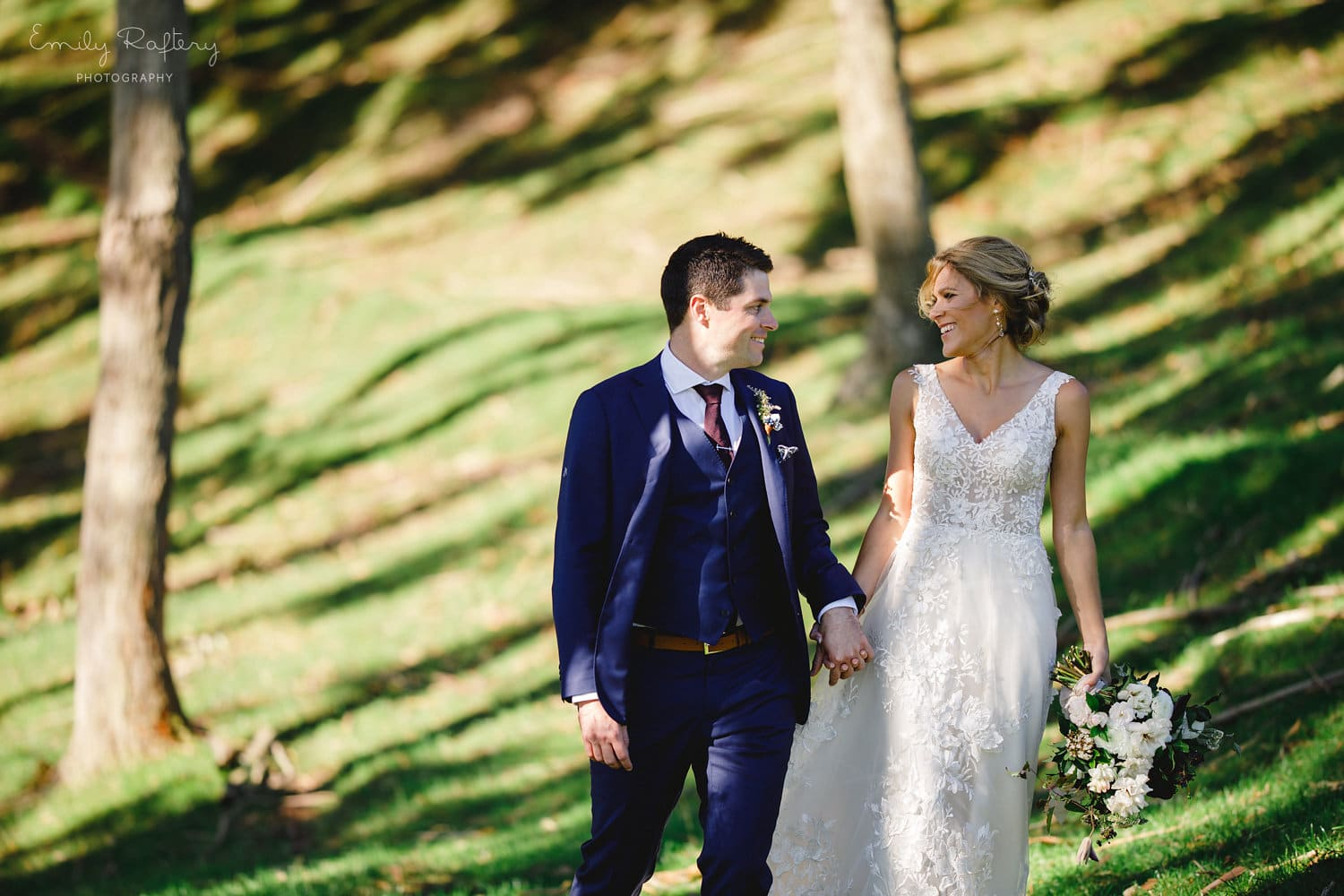 Real Weddings | Vinka Design | Real Brides Wearing Vinka Gowns | Helena and Tim walking through grounds at Kauri Bay Boomrock