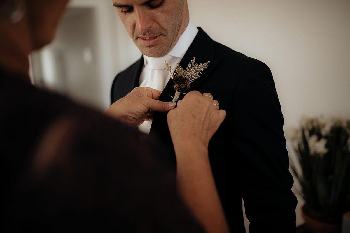 Real Weddings | Vinka Design | Real Brides Wearing Vinka Gowns | Lauren and Martyn - Martyn having flower added