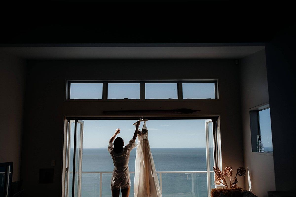 Real Weddings | Vinka Design | Real Brides Wearing Vinka Gowns | Lauren and Martyn - Mia wedding dress hanging in doorway