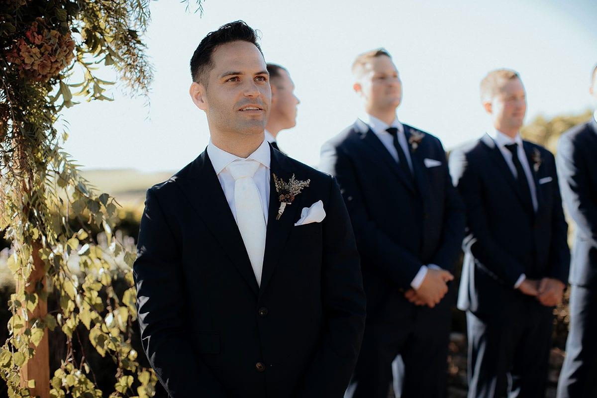 Real Weddings | Vinka Design | Real Brides Wearing Vinka Gowns | Lauren and Martyn - Martyn waiting for Lauren looking amazed