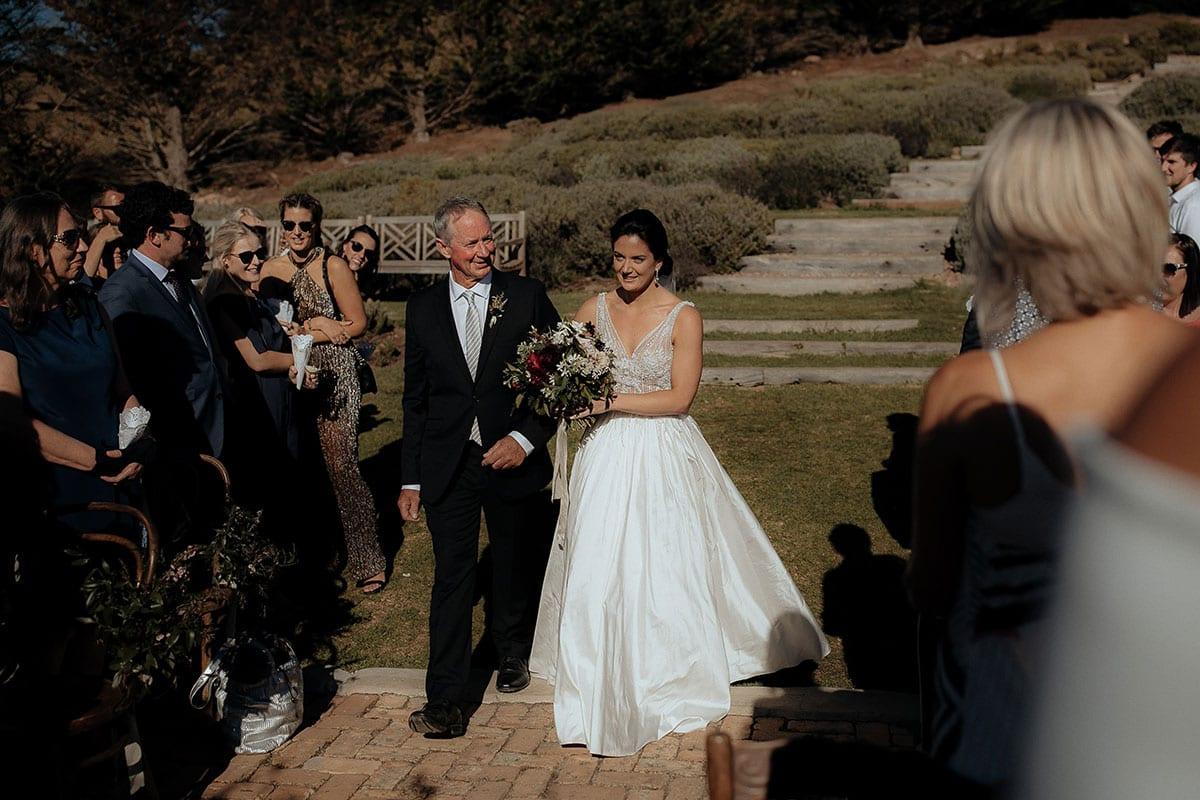 Real Weddings | Vinka Design | Real Brides Wearing Vinka Gowns | Lauren and Martyn - Lauren being walked down aisle