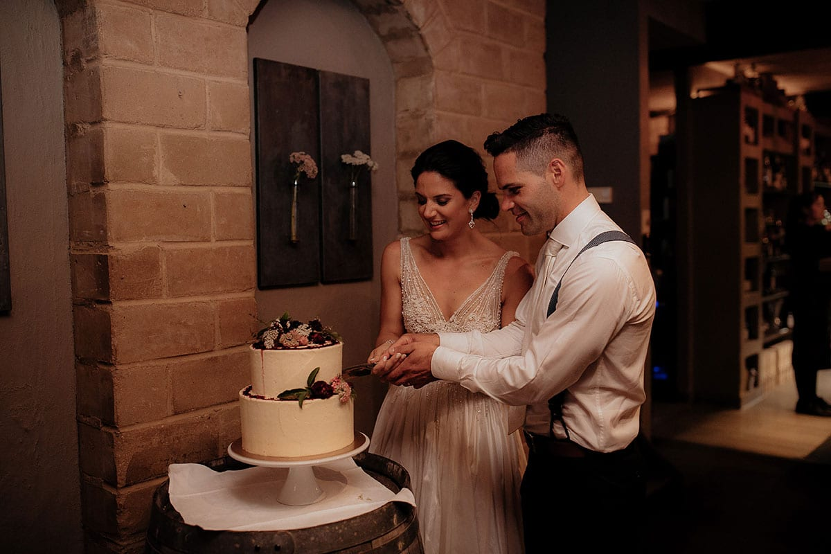 Real Weddings | Vinka Design | Real Brides Wearing Vinka Gowns | Lauren and Martyn cutting cake