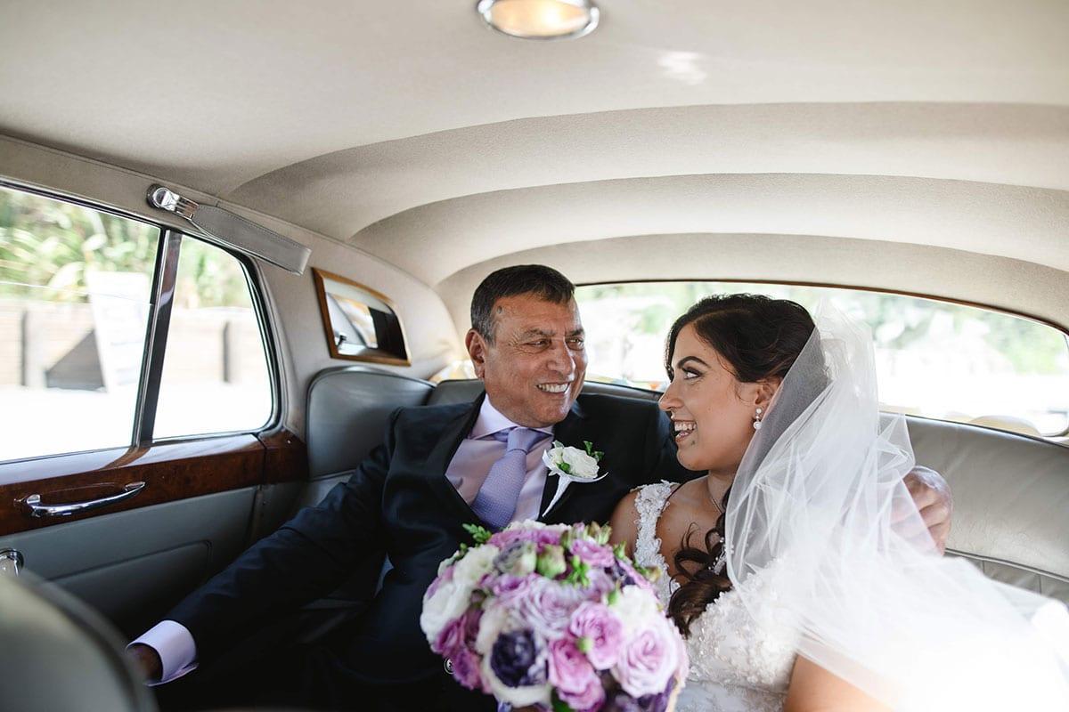 Real Weddings | Vinka Design | Real Brides Wearing Vinka Gowns | Ayesha and Nick in car
