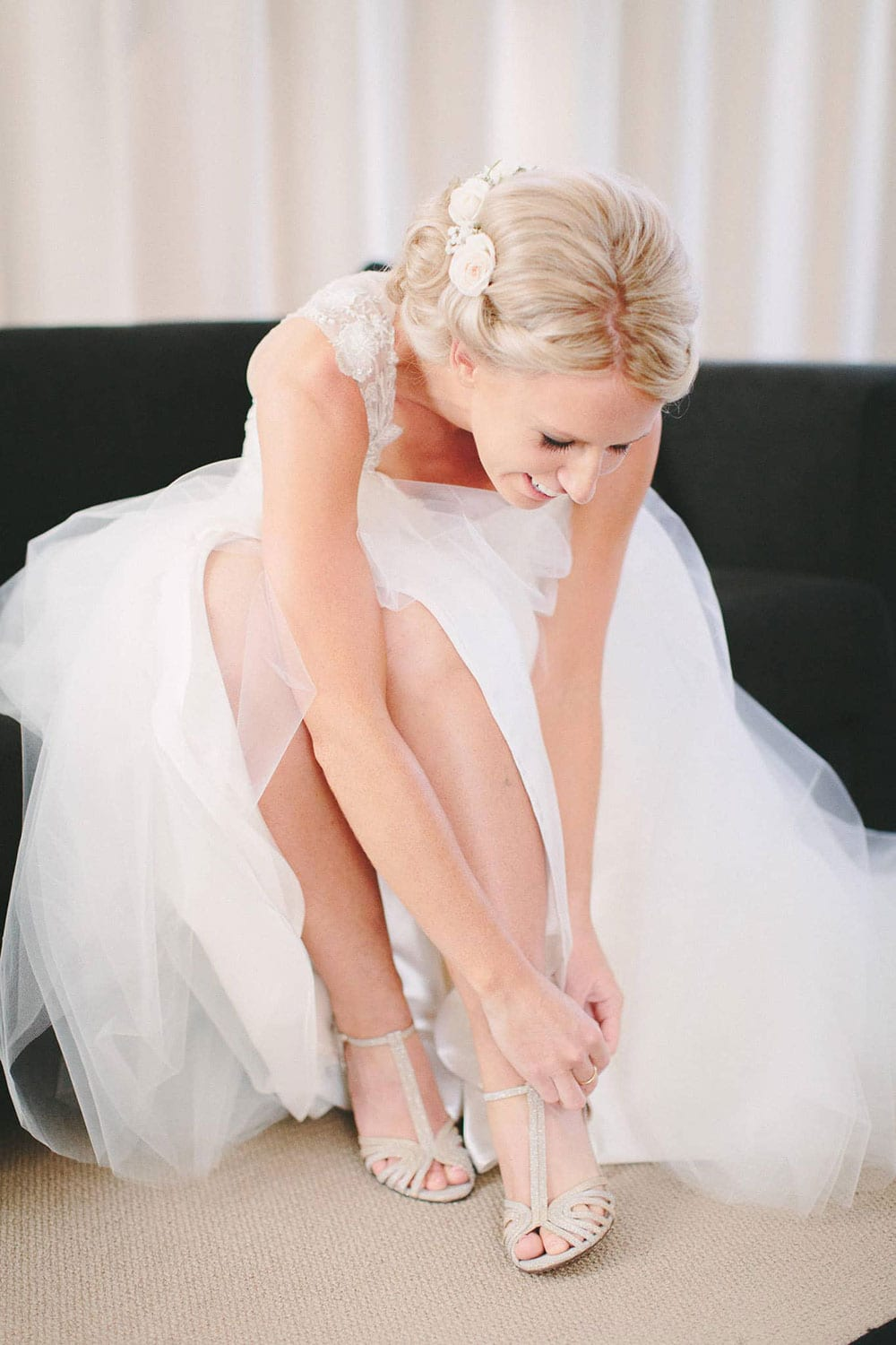 Real Weddings | Vinka Design | Real Brides Wearing Vinka Gowns | Louise and Ryan - Louise putting on wedding shoes