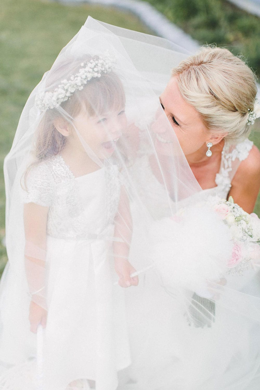 Real Weddings | Vinka Design | Real Brides Wearing Vinka Gowns | Louise and Ryan - Louise with flower girl in veil