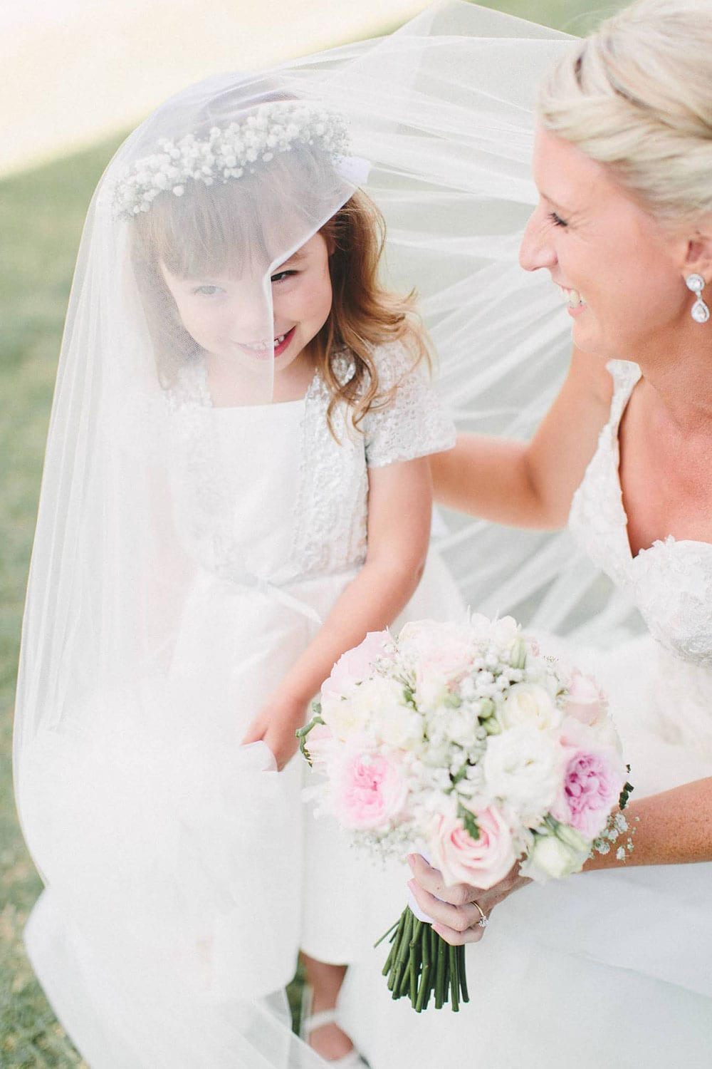 Real Weddings | Vinka Design | Real Brides Wearing Vinka Gowns | Louise and Ryan - Louise with flower girl