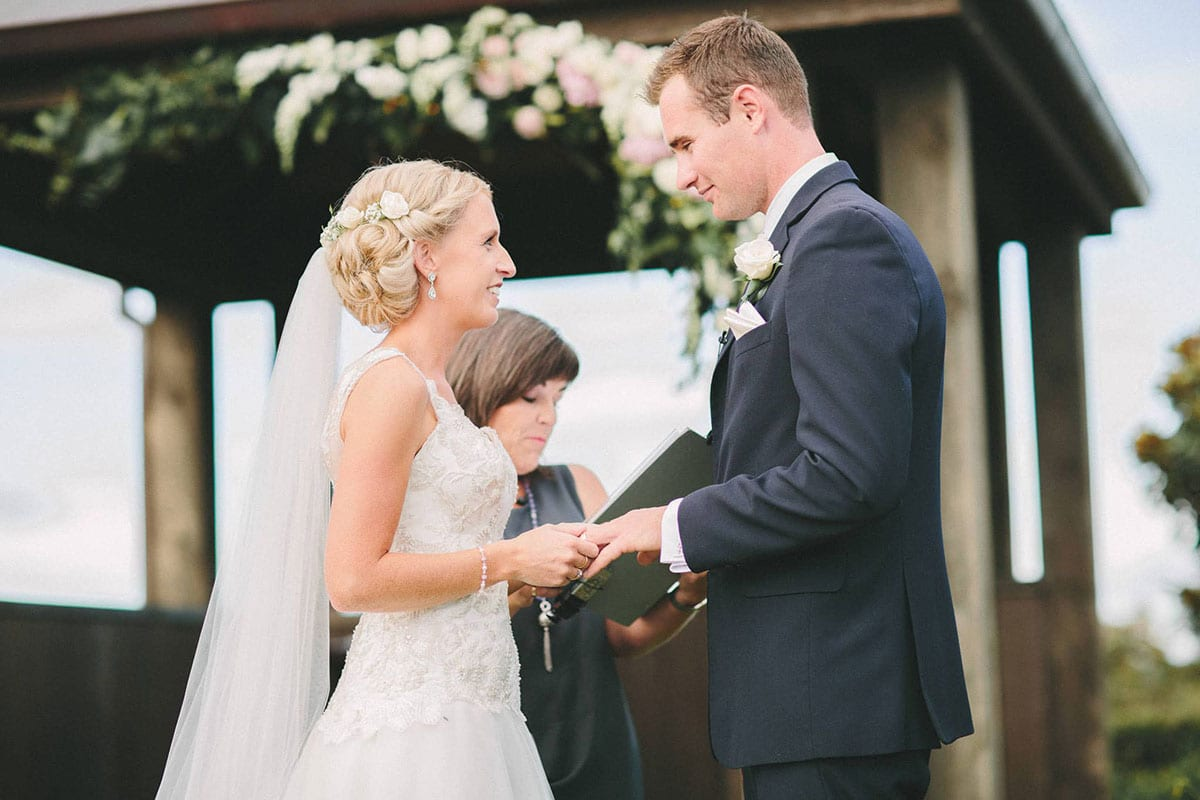 Real Weddings | Vinka Design | Real Brides Wearing Vinka Gowns | Louise and Ryan saying vows at wedding ceremony