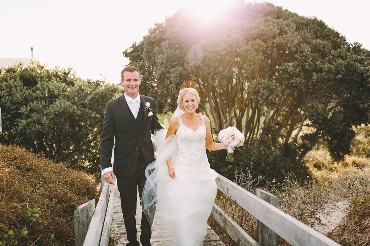 Real Weddings | Vinka Design | Real Brides Wearing Vinka Gowns | Louise and Ryan walking across bridge