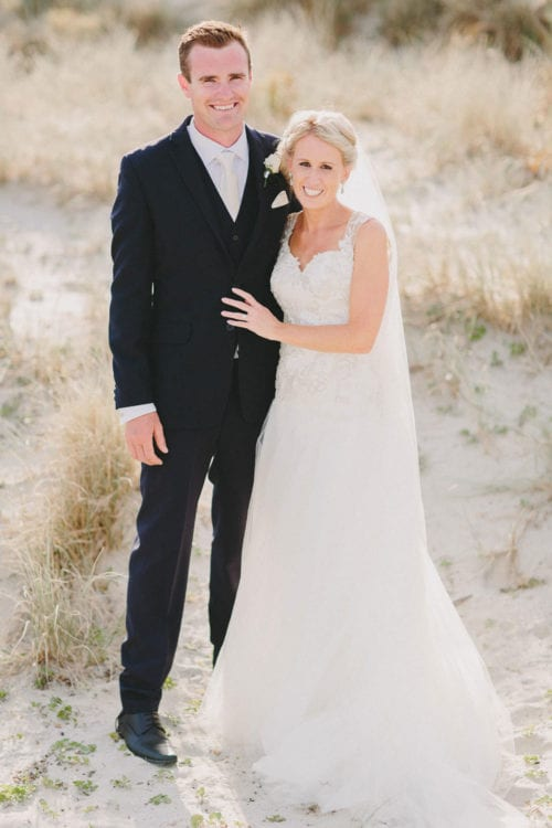 Real Weddings | Vinka Design | Real Brides Wearing Vinka Gowns | Louise and Ryan smiling portrait in sand dunes