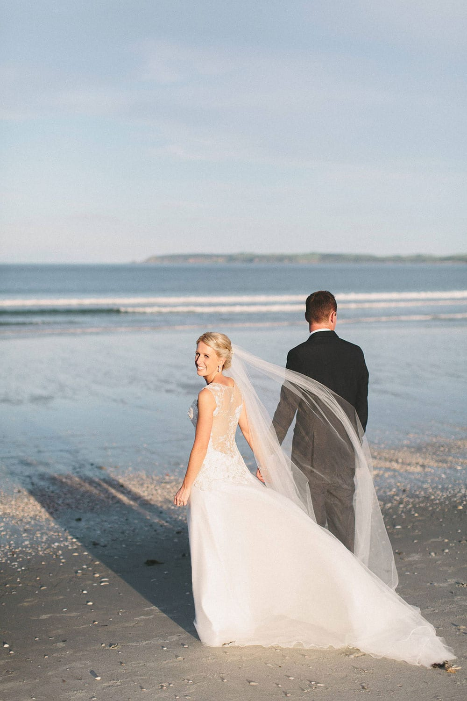 Real Weddings | Vinka Design | Real Brides Wearing Vinka Gowns | Louise and Ryan walking along the beach