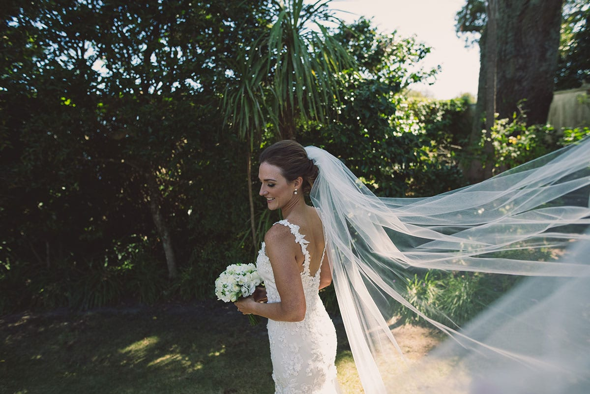 Real Weddings | Vinka Design | Real Brides Wearing Vinka Gowns | Claire and Paul - Claire in gardens with veil in breeze