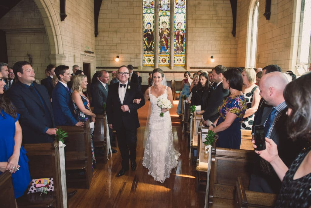 Real Weddings | Vinka Design | Real Brides Wearing Vinka Gowns | Claire and Paul - Claire being walked down the aisle