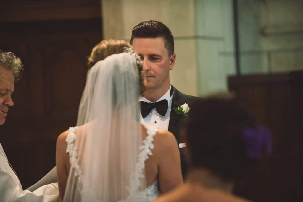 Real Weddings | Vinka Design | Real Brides Wearing Vinka Gowns | Claire and Paul church wedding ceremony face to face