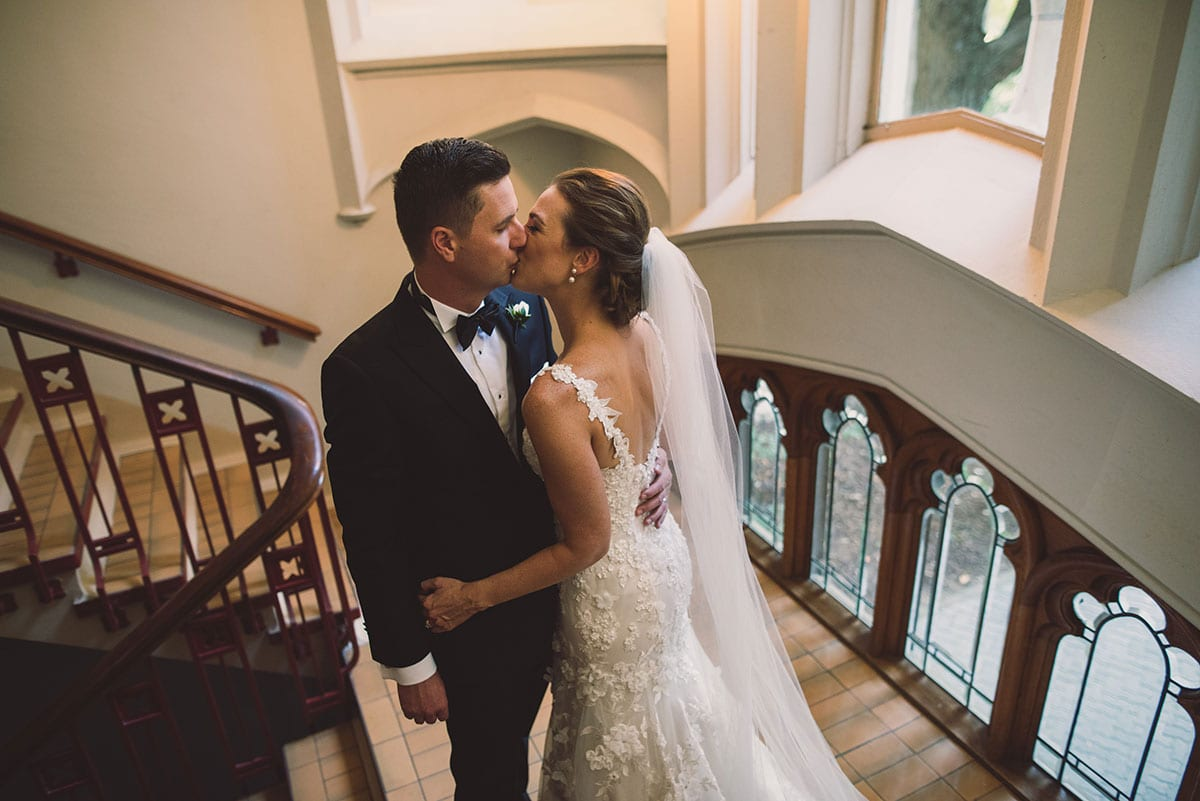 Real Weddings | Vinka Design | Real Brides Wearing Vinka Gowns | Claire and Paul in the Auckland University clock tower stairway