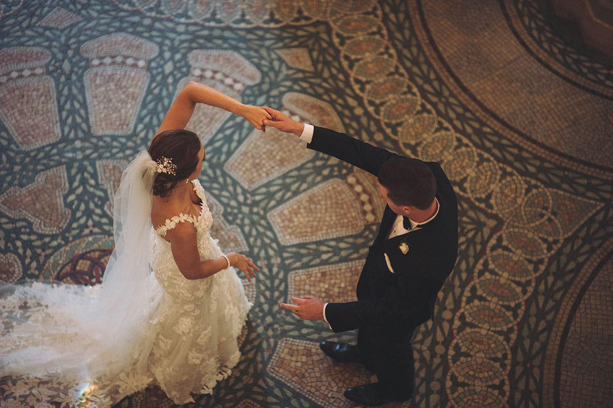 Real Weddings | Vinka Design | Real Brides Wearing Vinka Gowns | Claire and Paul dancing in the Auckland University clock tower