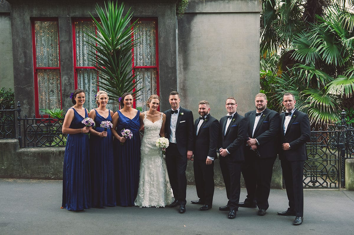 Real Weddings | Vinka Design | Real Brides Wearing Vinka Gowns | Candice and Michael with bridal party outside building