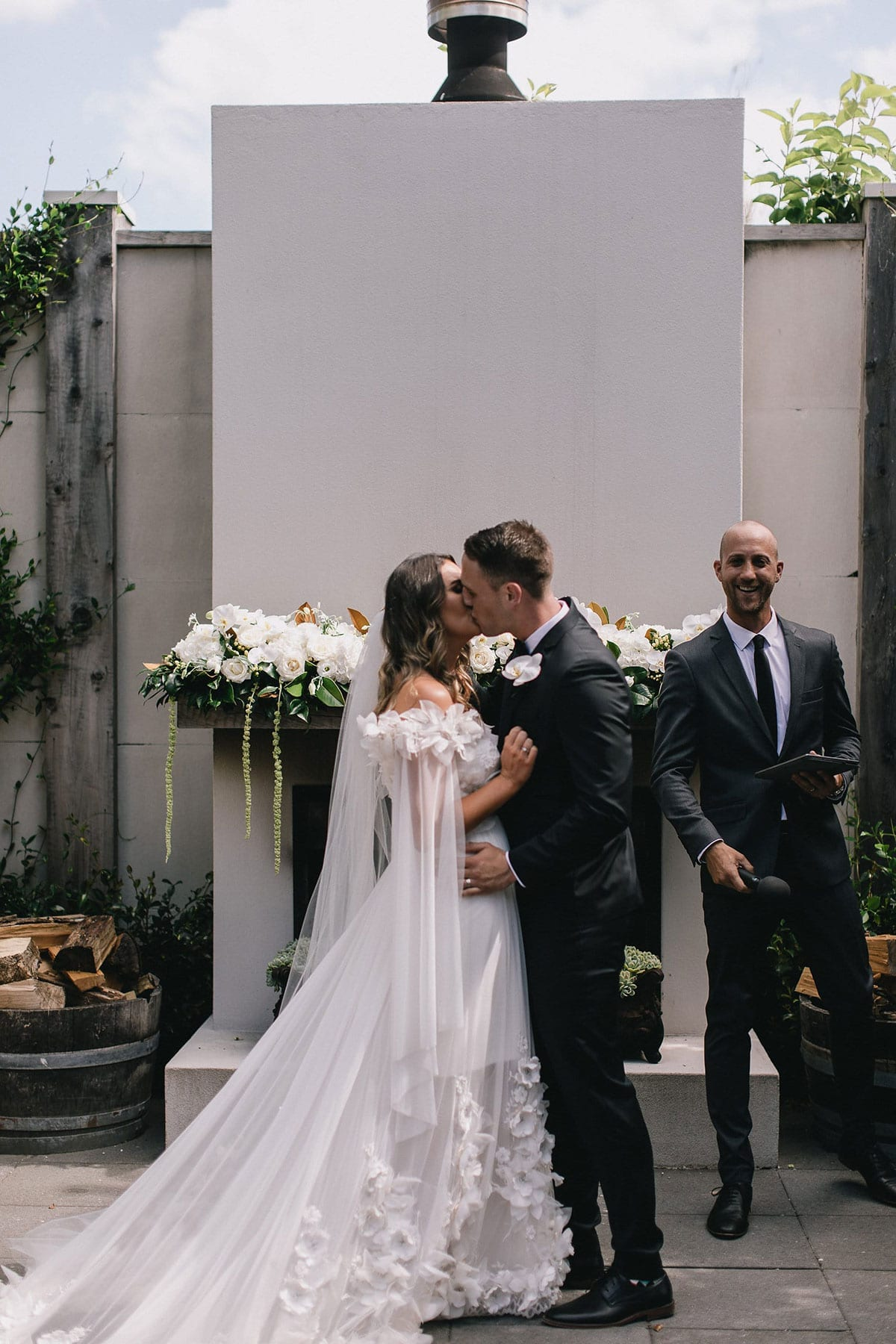 Real Weddings | Vinka Design | Real Brides Wearing Vinka Gowns | Candice and Michael kissing