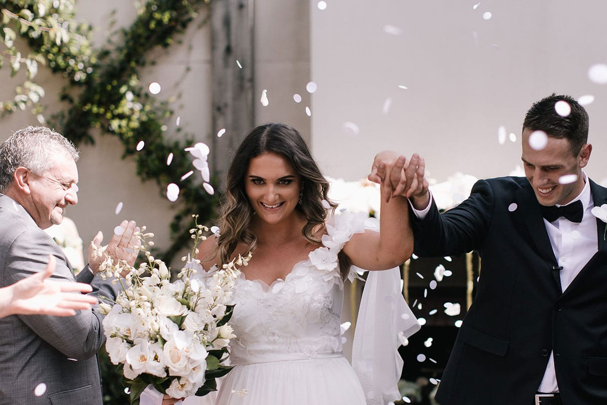 Real Weddings | Vinka Design | Real Brides Wearing Vinka Gowns | Candice and Michael in confetti