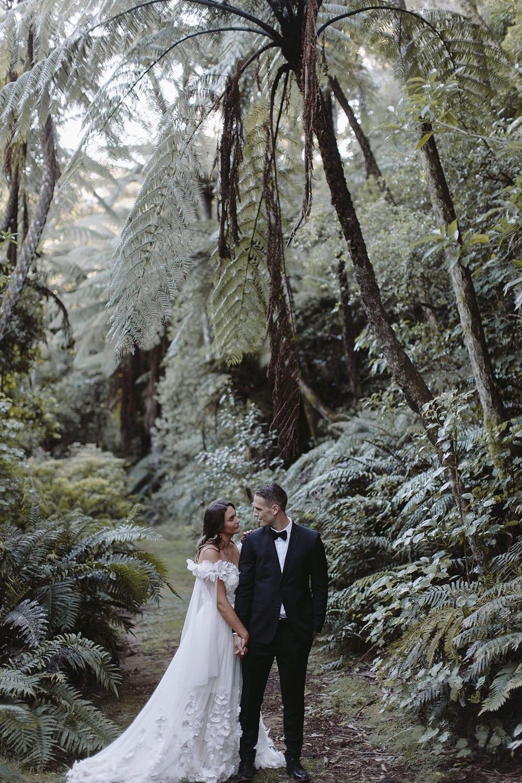 Real Weddings | Vinka Design | Real Brides Wearing Vinka Gowns | Candice and Michael walking through Ataahua Gardens Venue in Tauranga
