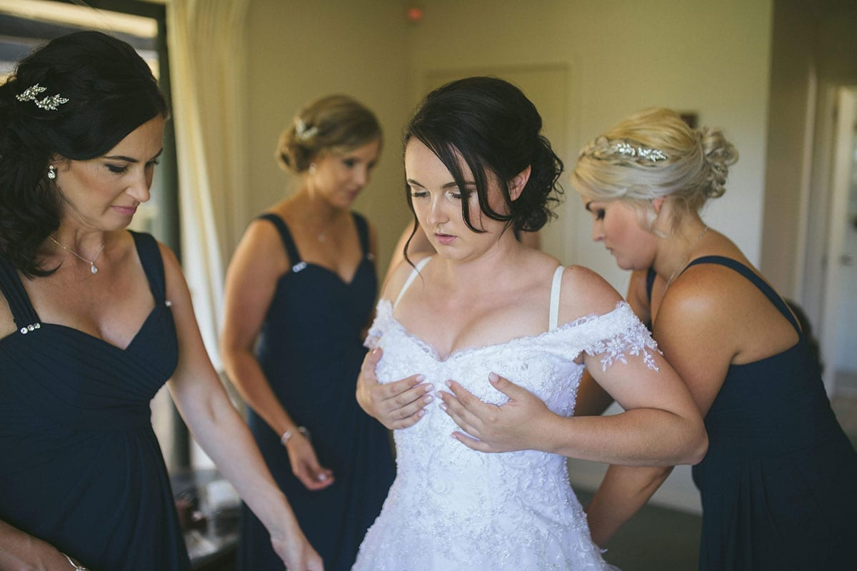 Real Weddings | Vinka Design | Real Brides Wearing Vinka Gowns | Bespoke gown with beaded lace bodice and tulle skirt | Kat and Logan - Kat getting ready
