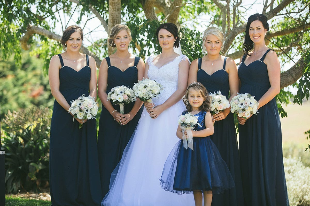 Real Weddings | Vinka Design | Real Brides Wearing Vinka Gowns | Bespoke gown with beaded lace bodice and tulle skirt | Kat and Logan - Kat with bridesmaids