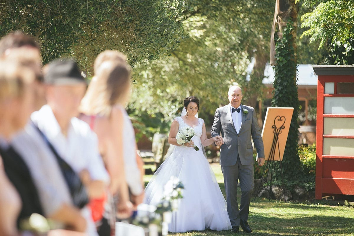 Real Weddings | Vinka Design | Real Brides Wearing Vinka Gowns | Bespoke gown with beaded lace bodice and tulle skirt | Kat and Logan - Kat walking down aisle