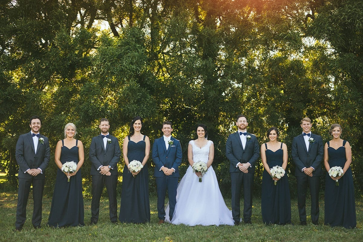 Real Weddings | Vinka Design | Real Brides Wearing Vinka Gowns | Bespoke gown with beaded lace bodice and tulle skirt | Kat and Logan with bridal party