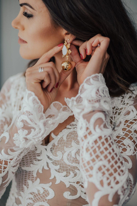 Real Weddings | Vinka Design | Real Brides Wearing Vinka Gowns | Hannah and Campbell - Hannah having adding bridal accessories earrings to bespoke ensemble
