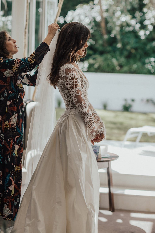 Real Weddings | Vinka Design | Real Brides Wearing Vinka Gowns | Hannah and Campbell - Hannah having veil added to bespoke ensemble