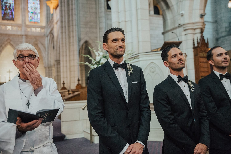 Real Weddings | Vinka Design | Real Brides Wearing Vinka Gowns | Hannah and Campbell - Campbell waiting at the altar