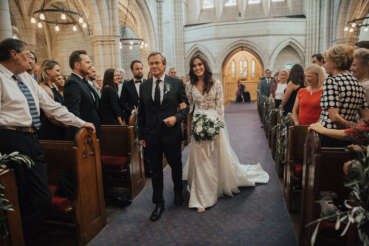 Real Weddings | Vinka Design | Real Brides Wearing Vinka Gowns | Hannah and Campbell - Hannah walking down aisle wearing bespoke Vinka ; her gown made in beaded lace