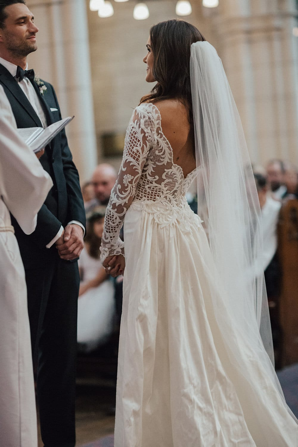 Hannah wearing bespoke Vinka ; her gown made in beaded lace has a low V back