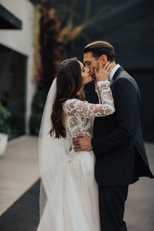 Real Weddings | Vinka Design | Real Brides Wearing Vinka Gowns | Hannah and Campbell kissing