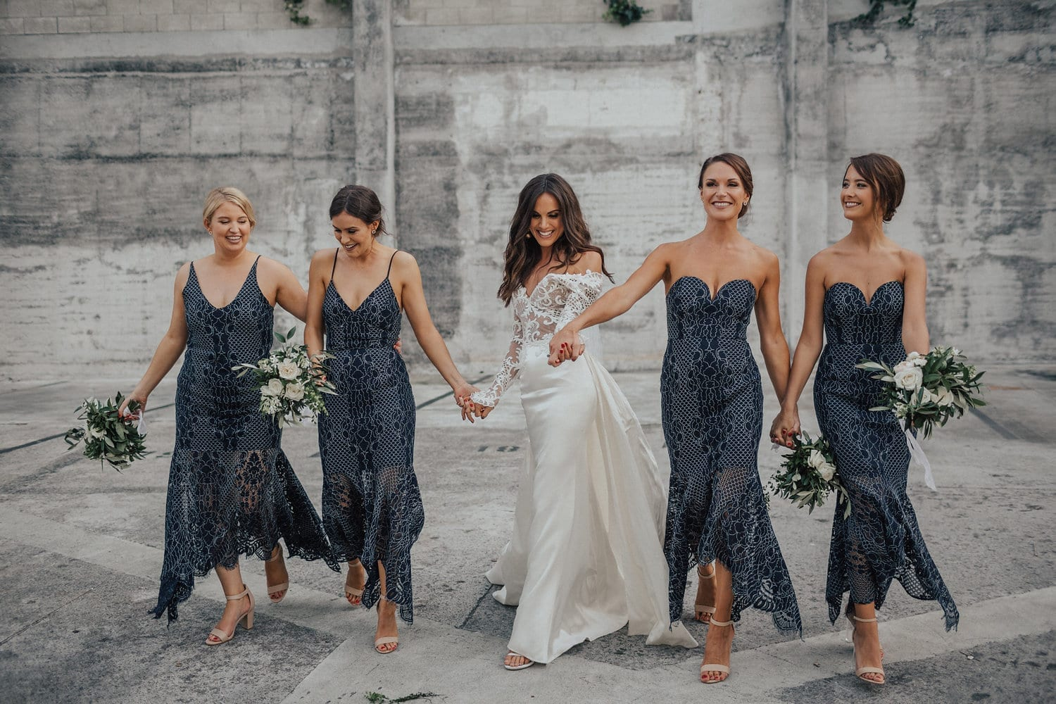 Real Weddings | Vinka Design | Real Brides Wearing Vinka Gowns | Hannah and Campbell - Hannah wearing bespoke Vinka Design, beaded lace bodice with deep V neckline , silk skirt and overtrain with bridesmaids