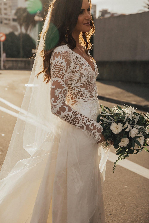 Hannah wearing bespoke Vinka Design, beaded lace bodice with deep V neckline , silk skirt and overtrain