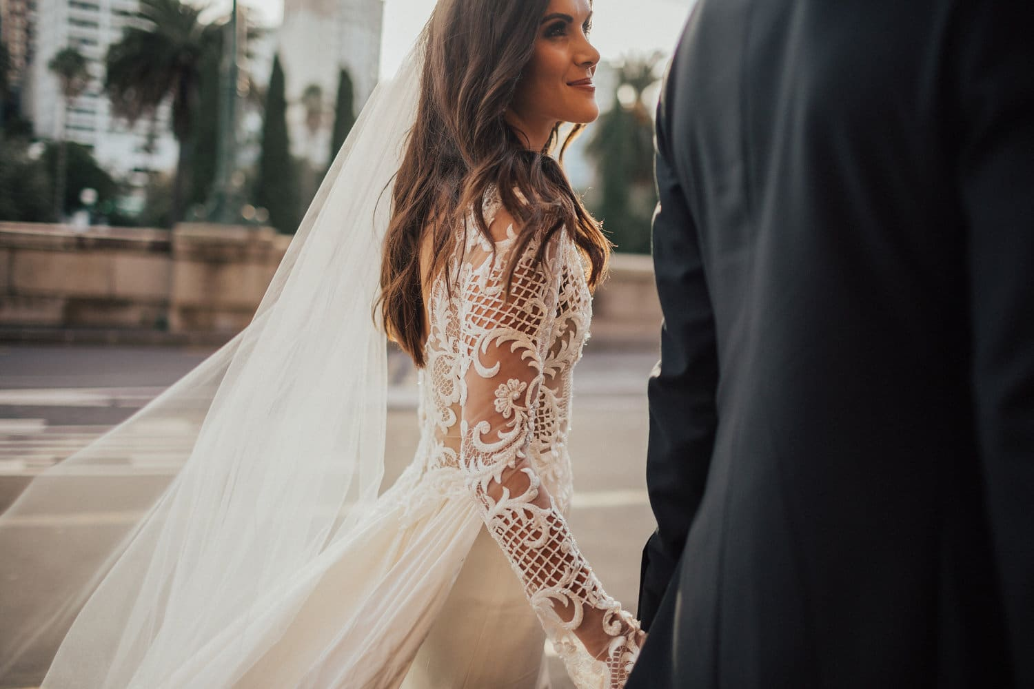 Real Weddings | Vinka Design | Real Brides Wearing Vinka Gowns | Hannah and Campbell - walking along close up of lace bodice embroidery detail